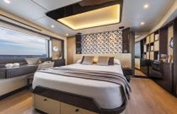 beautiful bedroom with overhead lighting